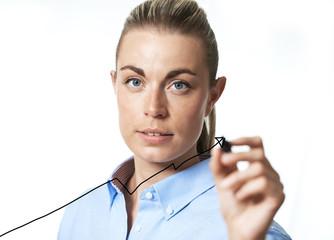 Businesswoman drawing an arrow graph