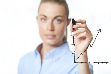 Woman drawing a graph on a virtual interface
