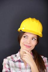 Young female architect, engineer or surveyor