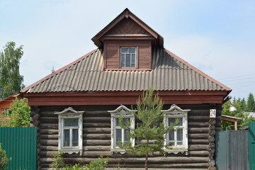 Old log house with carved platbands