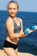 Portrait of healthy young woman in sportswear exercising