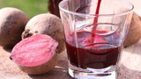 Pouring beetroot juice, close-up.