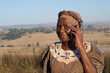 Traditional African Zulu woman speaking on mobile phone - 54378389