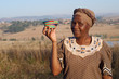 Traditional African Zulu woman selling wire baskets - 54378391