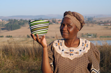 Traditional African Zulu woman selling wire baskets