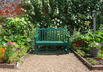 Bench seat in an english garden in early Spring