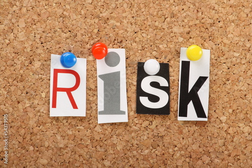 The word Risk on a cork notice board