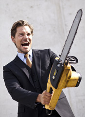 Angry businessman with blurred chainsaw