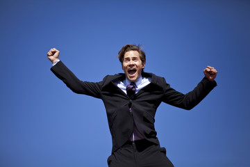 Excited businessman jumping