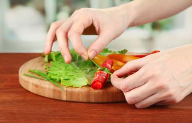 Process of preparing salami rolls, on bright background