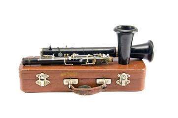 old used clarinet on brown leather box isolated on white