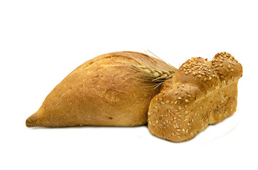 Challah and grey bread for Shabbat, isolated on white