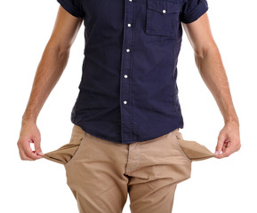 Man showing his empty pockets, isolated on white