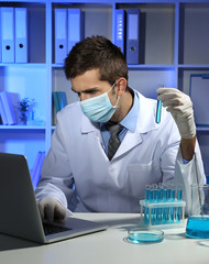 Young laboratory scientist working at lab