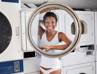 Woman Looking Through Washing Machine Door