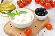 fresh mozzarella in a bowl, olives and cherry tomatoes