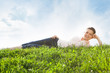 Young Woman Relaxing In Grassland