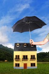 casa con paraguas