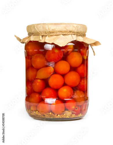 Marinated tomatoes in glass jar