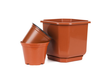Gardening tools: empty flower pots isolated on white