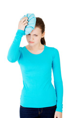 Woman with ice bag for headaches and migraines