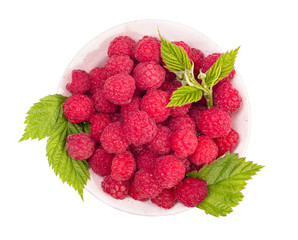 Raspberries in bowl top view