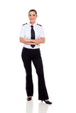female young airline co-pilot with arms crossed