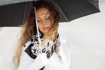 Sad beautiful woman with umbrella