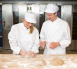 Instructor and baker apprentice kneading bread dough