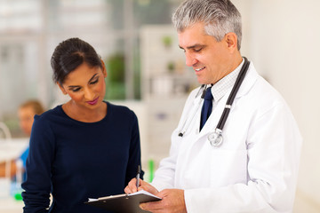 senior doctor checking patient's test result