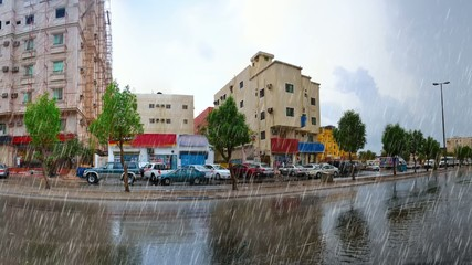 heavy rain over jeddah street in at afternoon