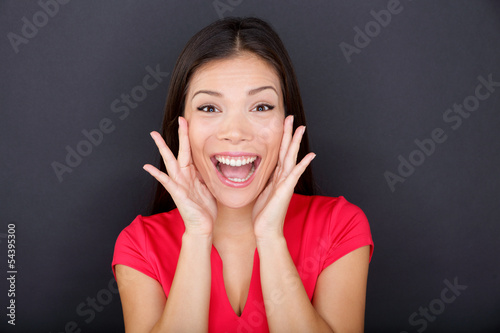 Screaming girl on black background