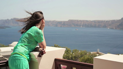 Pensive beautiful woman looking at amazing view on terrace