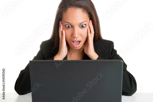 Woman in Panic Looking At A Computer Monitor