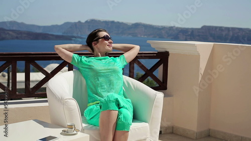 Happy beautiful woman relaxing on beautiful terrace