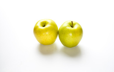 Two Golden Delicious Apples on White Counter