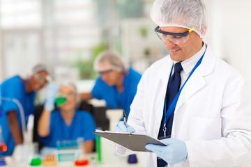 senior scientist writing medical report