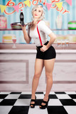 Pinup woman serving drinks at vintage candy bar