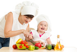 Chef mom and kid preparing healthy food