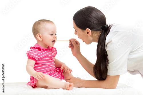 doctor examining baby isolated on white background