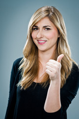 Young Happy Woman Smiling with Thumbs Up