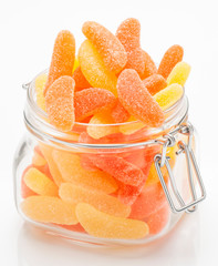 sugary gummy orange and lemon in glass jar