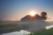 sunbeams over farmhouse