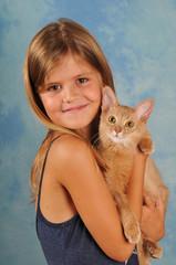 Beautiful girl with somali kitten portrait