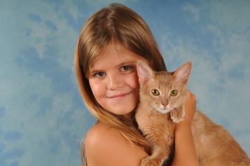 Lovely portrait of girl with kitten