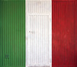 Italian flag on the background of old locked doors