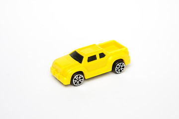 Yellow toy car on a white background