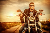 Biker on a motorcycle - 54404523