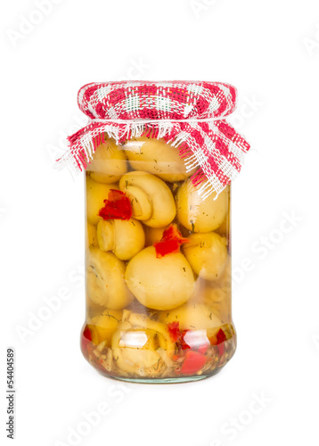 Marinated mushrooms in a glass jar