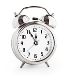 Silver alarm clock showing twelve hours with clipping path with